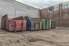 Huge steel containers place on the ground near a building stock photo