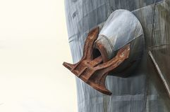 A huge rutsy ship`s anchor. A huge ship`s anchor hanging from a tanker Royalty Free Stock Photo