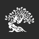 Huge and sacred oak tree silhouette logo badge isolated on dark background. Royalty Free Stock Photography