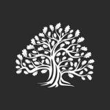 Huge and sacred oak tree silhouette logo badge isolated on dark background. Stock Photo