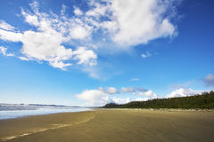Huge sandy  beach on a midday Stock Images