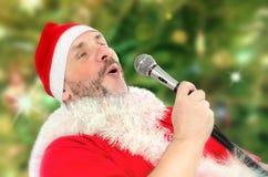 Huge Santa Claus belting Ho-ho-ho Royalty Free Stock Photos