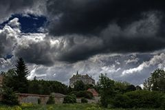 Huge scary ancient creepy castle on the top of the hill under dark cloudy sky. In Ukraine royalty free stock photos
