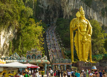 The huge sculpture in front of the entrance to holy Batu caves. Enormous gold statue and high stairs in Kuala Lumpur, Malaysia Royalty Free Stock Photo