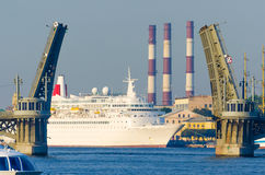 Huge sea liner in the bridges. River Royalty Free Stock Photo