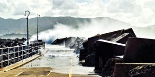 Huge seas breaking over the Coffs Harbour Marina breakwall. Royalty Free Stock Photography