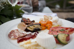 Huge selction of beautiful italian anti pasti food for a big sta. Sausages, meats and cheeses from italy in a typical starter dish royalty free stock images