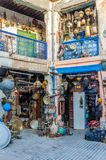 Huge selection of pots, lamps, lantern and other metal works in shop of souk in medina of Fez, Morocco, North Africa.  royalty free stock images