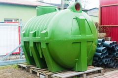 Huge septic tank. Huge, green, plastic septic tank Royalty Free Stock Photography