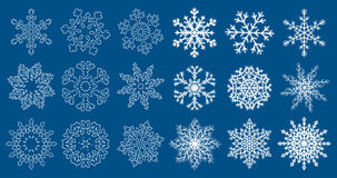 Huge set of blue snowflakes. Set of white flat and linear snowflakes isolated on blue background. Vector illustration Royalty Free Stock Photos