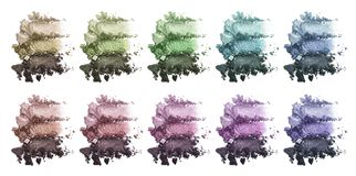 A huge set of multi-colored triple eye shadow. Crushed eyeshadow. makeup product Stock Images