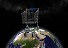 Huge shopping cart on earth Royalty Free Stock Image
