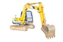A huge shovel digging on ground. Royalty Free Stock Images