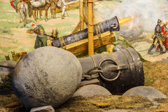 Huge siege cannon used in the final assault. And  fall of Constantinople in 1453. Diorama in Askeri Museum, Istanbul,  Turkey Royalty Free Stock Images