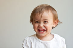 Huge smile on 1 year old's baby face Stock Photo