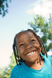 Huge Smile!. A happy girl with a huge smile looks into the distance on a bright sunny day Royalty Free Stock Image