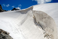 Huge snow-covered crevasse. With a snow cornice Royalty Free Stock Images