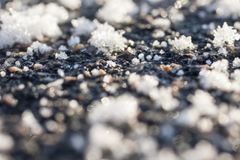 Huge snow flakes on ground surface. Very cold weather concept background Royalty Free Stock Photos