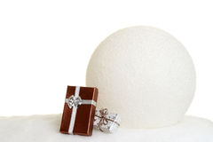 Huge snowball with gifts Royalty Free Stock Photos