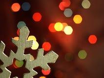 Huge snowflake and magic bokeh Royalty Free Stock Images