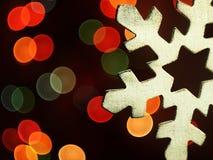 Huge snowflake and magic bokeh. Royalty Free Stock Photography
