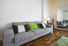 Huge sofa. Large contemporary stylish fabric sofa in a bright lounge Stock Photo