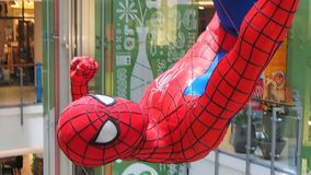 A huge Spider-Man figurine displayed at a Bangkok shopping-mall stock footage