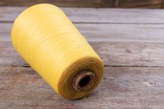 Huge spool of yellow yarn Royalty Free Stock Photo