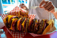 A huge stacked burger and fries Stock Image