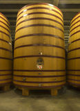 Huge, standing-up cask wherein beer or wine is aged. Huge, standing-up, wooden cask wherein beer or wine is aged for several years Stock Image