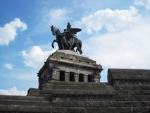 Huge statue. Of emperor wit his horse made from copper under of blue sky Royalty Free Stock Photography