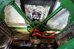 The huge steel flywheel of an industrial steam engine used at a. Tin mine in Cornwall Stock Images