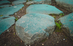 Huge stone as a component  of pavers which was used in ancient Rome. Royalty Free Stock Images