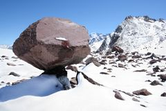 Huge stone block like mushroom in snow mountains Stock Photography