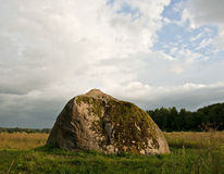 Huge stone in a field. Stock Image