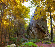 Huge stone in the forest. Huge stone in the autumn forest Stock Photography
