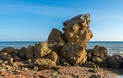 Huge stone by the sea. On a Sunny autumn day on the seashore near the village of Fontanka, Odessa region, Ukraine royalty free stock images