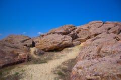 Huge stones against sky background. Huge  stones against sky background, huge stones against the blue sky Stock Image