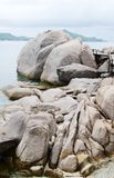 Huge stones boulders and plank bridge Royalty Free Stock Photography