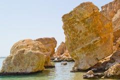 Huge stones lying in the sea Stock Photo