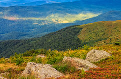 Huge stones on the meadow on top of mountain ridge royalty free stock photos