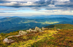 Huge stones on the meadow on top of mountain ridge stock images