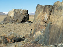 Huge stones on a sacred place in steppe. Stock Images