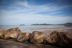 Huge stones on the seashore. Huge rocks framing the path along the seashore stock photo