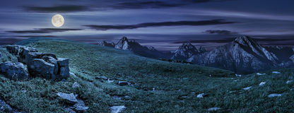 Huge stones in valley on top of mountain range at night stock photos