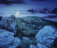 Huge stones in valley on top of mountain range at night Stock Photo