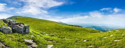 Huge stones in valley on top of mountain range stock photo