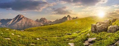 Huge stones in valley on top of mountain range at sunset Stock Images