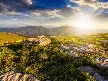 Huge stones in valley on top of mountain range at sunset Royalty Free Stock Photo