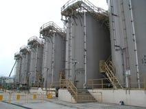 Huge Storage Tanks. Lots of giant tanks storing Chloride Royalty Free Stock Image